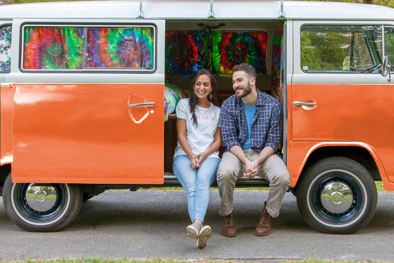 Couple sitting on bus door